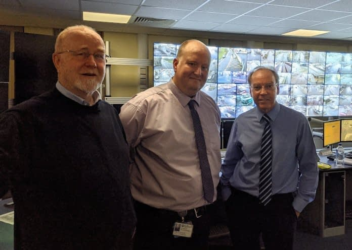 photo of members of the Chamber of Trade with CCTV control room manager