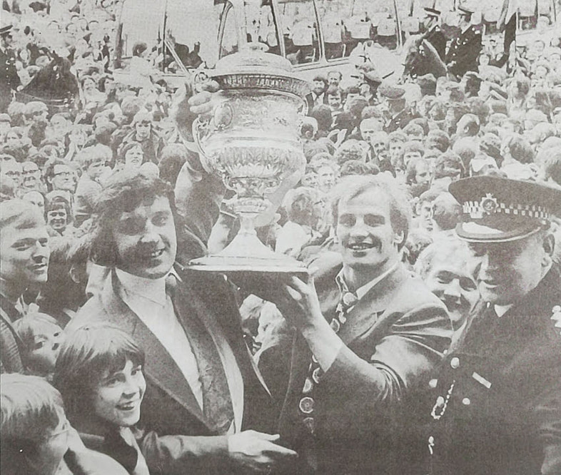 photo of A hero's welcome for the triumphant Crown Flatt side - Mick Stephenson, right, with Dewsbury club mnager Mich Lumb, with the Rugby League Championship Cup 1973