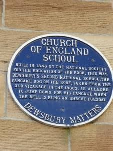 photo of the blue plaque erected on Howlands, Dewsbury