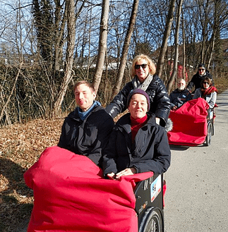 photo of trishaw with 2 passengers