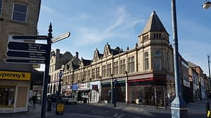 photo of shop fronts in Corporation Street, Dewsbury aimed to help regeneration
